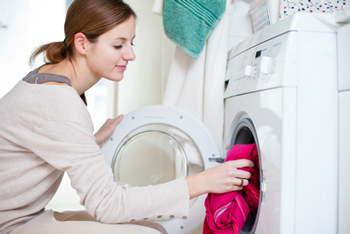 woman doing laundry for senior